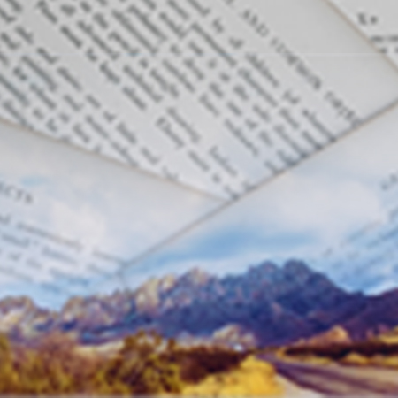 new mexico mountains with image of typed papers overlaid