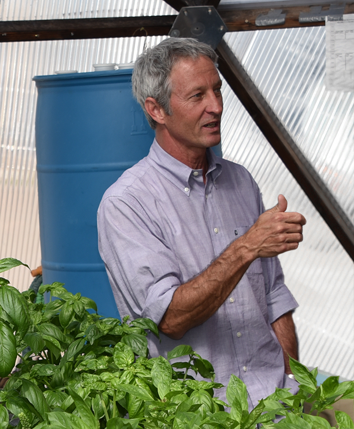 Luke Spangenburg giving a tour in the SFCC greenhouse in 2015